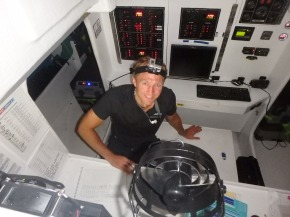 DJ working on the log in Nav station