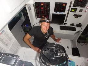 DJ working on the log in Nav station