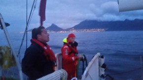 Cape Town in the distance. Dimitri at the helm talking with Matt