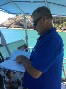 Wayne making notes after pickup in his office on board