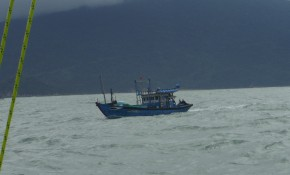 Fishing boat in the bay. We had to hang out here until they sent a pilot boat to take us in.