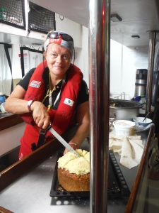 Judith and her Coconut cake for Hans birthday! YUM!