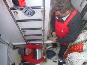 Mark and Justin cleaning out bilges in sail locker