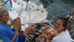 While stopped, Kat was sewing on some mast sliders and my foot was helping hold sail out of the way!