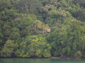 House in the trees along the shore on the way into fueling stop.